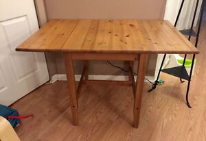 Solid wood double leaf drop down table.
