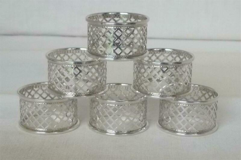 A STUNNING SET OF SIX SOLID STERLING SILVER PIERCED ENGLISH NAPKIN RINGS 1996.