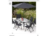 8 piece black Hawaii table and chairs brand new