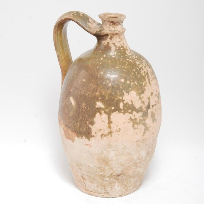 ANTIQUE EARTHENWARE JUG WITH OLIVE TO AMBER GLAZE POSSIBLY FRENCH