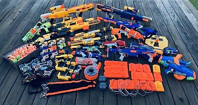 Lot of 33 Assorted Nerf Guns with Bulletts Glasses Magazines (N-Strike Modified)