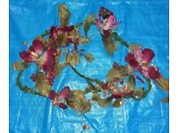 Large Garland with Red/Pink flowers.