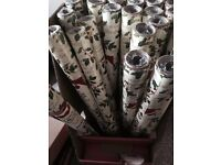 25 rolls of Christmas wrapping paper