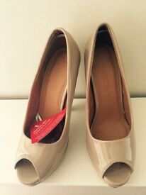 nude peep-toe heels,size 5. Brand new with tags
