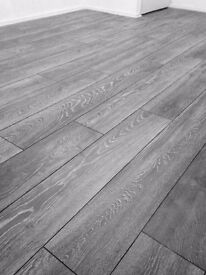 8mm laminate flooring supplied, delivered and fitted 20m £320.