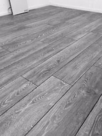 8mm Ac4 laminate flooring fully supplied and fitted with underlay, beading and door finish.
