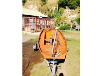 Mirror gaff rigged sailing dinghy
