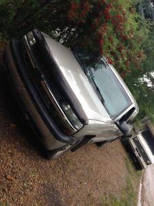1999 Chevy Silverado.  trade for manual car