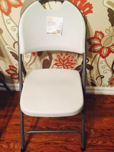 Clean white chairs and tables for rent