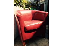 Red leather tub armchair in very good condition for sale
