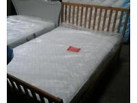 ..Designer double wooden bed frame and air sprung mattress new ex display model