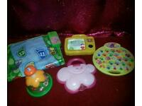 Toy bundle. Includes walk and learn mat, peppa pig game, small laptop and spinning toy.