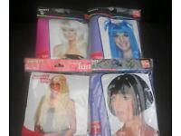 Job lot of four ladies fancy dress wigs.