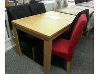 A brand new 150cms dinning table with 4 red fabric skirted chairs.