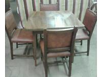 EXTENDING DINNING TABLE AND 4 STUDDED BACK CHAIRS