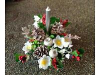 Christmas table arrangement with candle, artificial flowers
