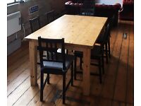 Large solid wood dining table with 6 chairs