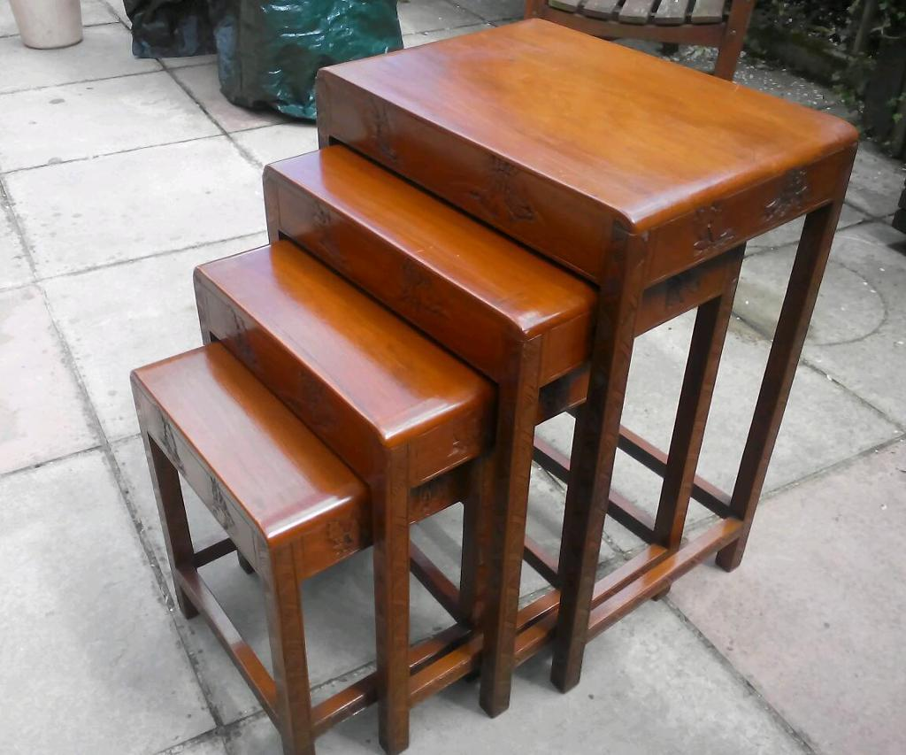 Vintage Oriental nest of four side tables.