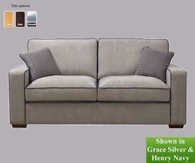 Hardly used three seater sofa bought from Chrystie's Hawick, grey/silver with navy piping