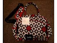 Brand new changing bag + a free baby travel hug