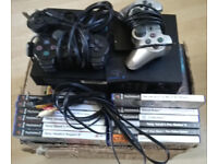 PS2 + 74 Games + 2 Controllers + 1 Memory Card