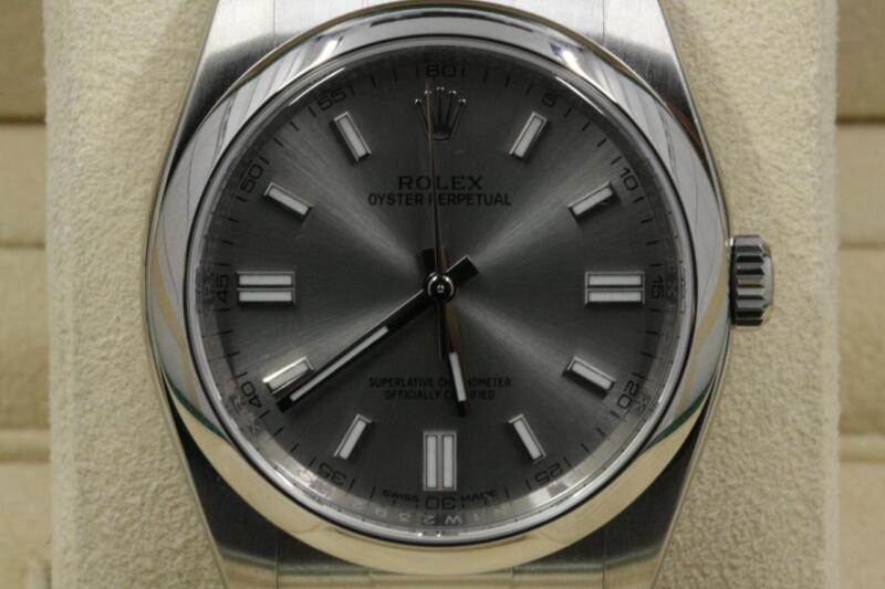 Rolex Oyster Perpetual 116000 Stainless Steel Watch  Steel Dial Unworn