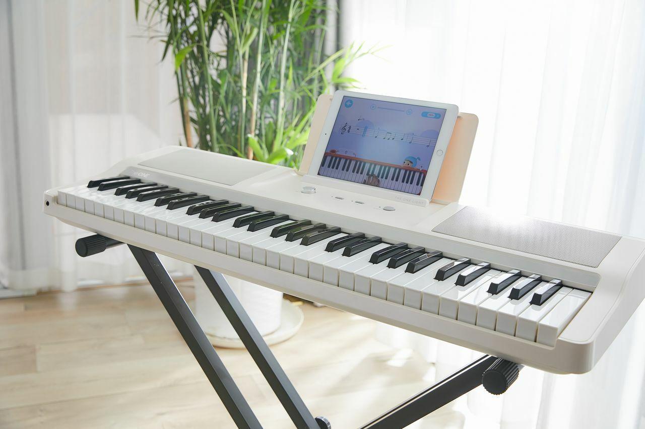 The ONE Light Keyboard Piano 61-Key Portable Keyboard Electr