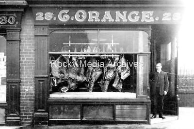 Qid-16 C Orange Butcher Shop Front, Burton Road, Dewsbury Road, Leeds. Photo