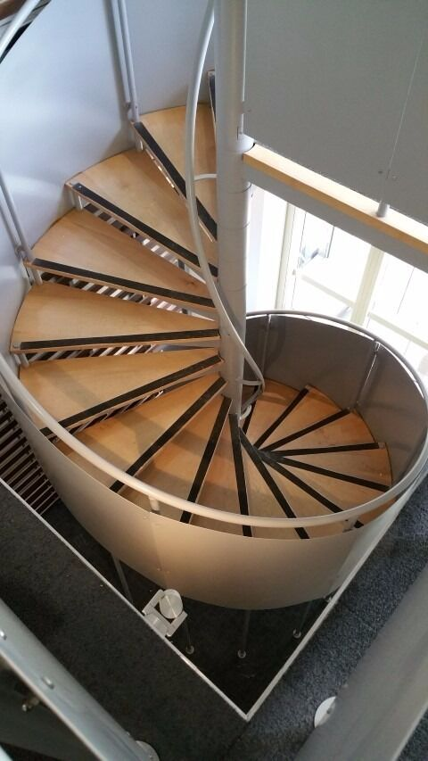 USED SPIRAL STAIRCASE WITH GREY METAL SAFETY PANELS, HANDRAILS U0026 19 WOODEN  STEPS NEAR LONDON