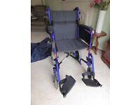 Invacare foldable portable Wheelchair plus rain poncho good condition