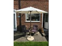 Parasol, base and two padded swivel chairs