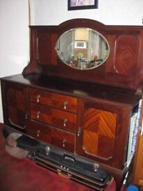 Antique mahogany sideboard with oval mirror