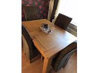 Bargain. Extending Solid Oak Dining Table and Chairs, excellent condition.Reasonable offers consd.