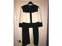 Ladies suit ideal for weddings.