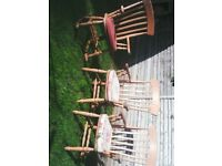 large pine cottage style dining chairs. 3 of. and one is a rocker