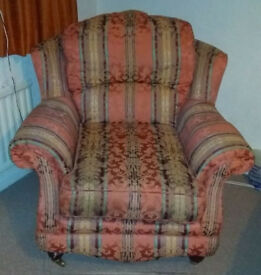 Armchair with padded headrest