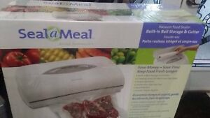 Wow brand new in sealed box Vacuum Food Sealer for $85