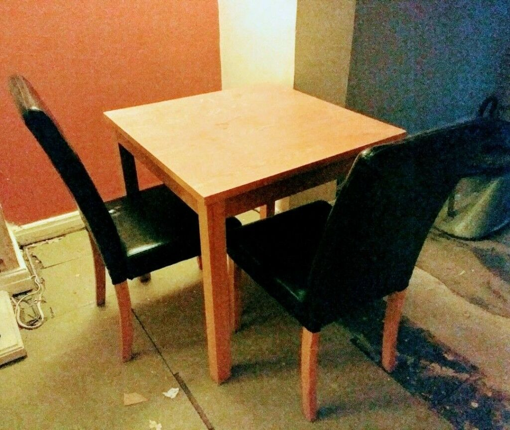 Breakfast table with two chairs