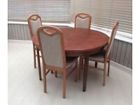 Teak round extending dining table & 4 chairs