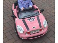 Pink mini battery powered ride on. Excellent condition.
