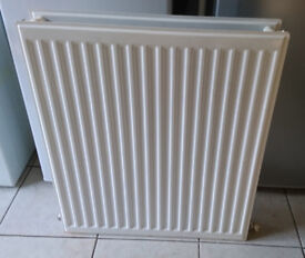 Small double panel radiator. Approx 23 inches wide, 27 inches high