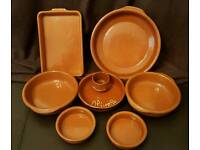 Terracotta tapas dishes and a olive one