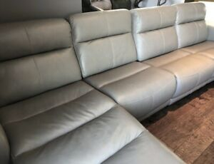 Leather reclining sectional- (BRAND NEW)