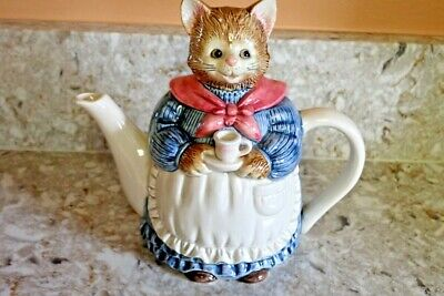 Daisy unique gift for a cat lover! Ceramic cat bell with an off-white shiny glaze