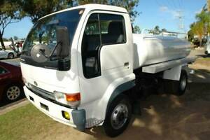 1998 MK211 NISSAN CONDOR 3700LTR VACUUM TANKER WITH SIDE TRAYS. Arundel Gold Coast City Preview