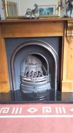 cast iron back panel and gas fire.
