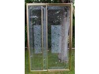 Gold Pivot Shower Door -Celtic design