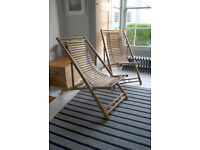 Two matching solid bamboo deckchairs/ lounging chairs