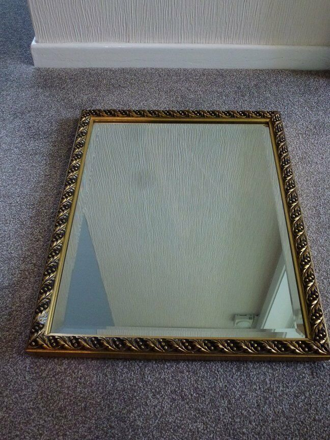Rectangular mirror with gold coloured surround