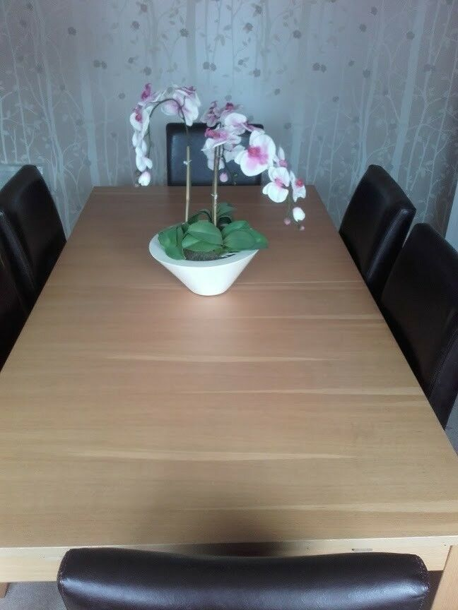 Extendable Dining table and 6 leather chairs (can sell ...